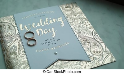 Wedding day postcard and rings - Wedding day blue postcard...