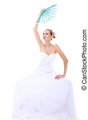 Wedding day. Romantic bride in white dress fan isolated