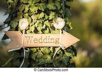 Wedding decor. Wooden plaque with the inscription Wedding....