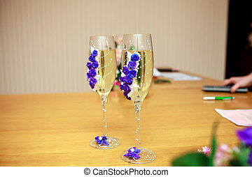 Wedding decorated glasses of champagne on table
