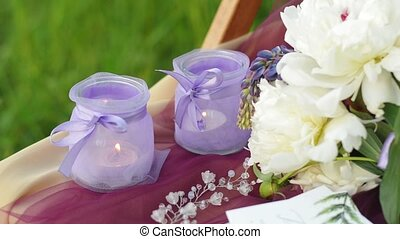 Wedding decoration ceremony in purple colors. Candlesticks...