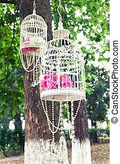 Fancy white vintage birdcage as a wedding decoration