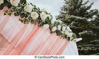 Wedding decoration of the arch. Wedding arch decorated with flowers.