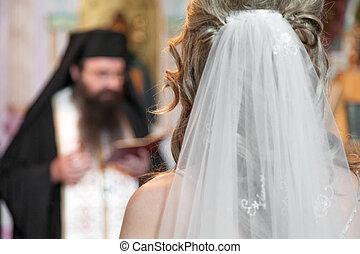 Wedding decoration - Priest during a orthodox wedding ...