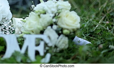 Wedding decoration word love , flowers on a background of green grass in the park