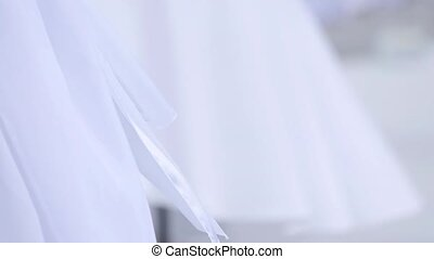 Wedding decorations of white fabrics and flowers on the beach before the ceremony