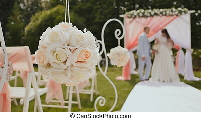 Wedding decorations on chairs made of flowers in the open...