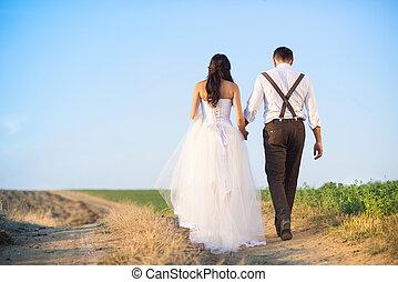 Wedding details in nature - Bride and groom walk in summer...