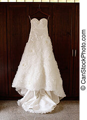 Wedding dress. - Beautiful wedding gown hanging before a...