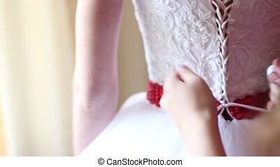 wedding dress bow on a corset