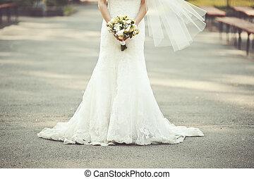 wedding dress, bride holding a bouquet