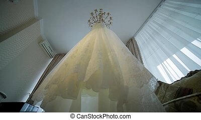 Wedding dress. - Elegant white wedding dress hanging in the...