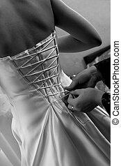 Wedding-dress - Fiancee puts a wedding-dress on. kind from...