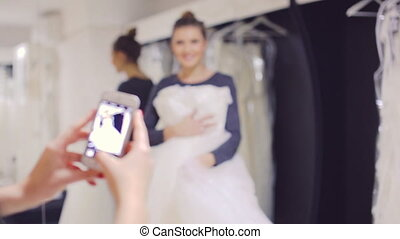 Wedding Dress Fitting in Bridal store and be photographed