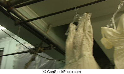 Wedding dress hanged. - A worms eye view shot of a wedding...