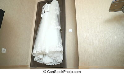 Wedding dress hanging on a shoulders