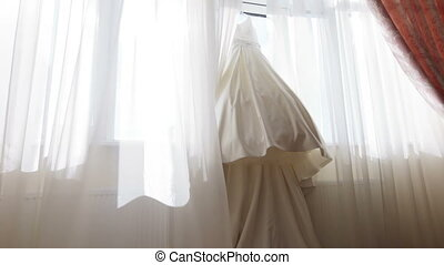 Wedding Dress - Hanging on windows of expensive wedding...