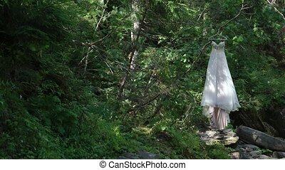 Wedding dress in a forest