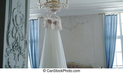 Wedding dress in bedroom on lamp
