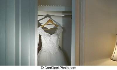 Wedding dress in wardrobe - Wedding white dress in wardrobe