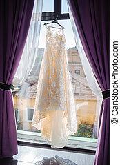 Wedding dress in white room.