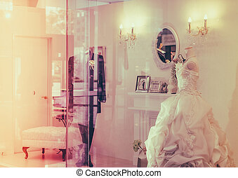 Wedding dress in window display . ( Filtered image processed...