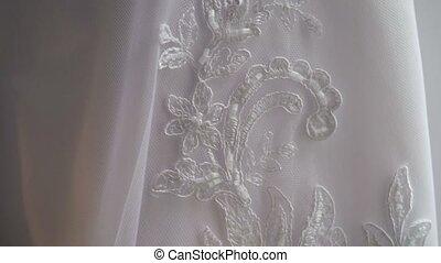 Wedding dress lace closeup pan