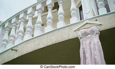 Wedding dress on a balcony