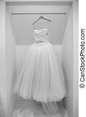 Wedding dress on a hanger in black and white