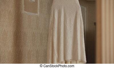 Wedding dress on a hanger