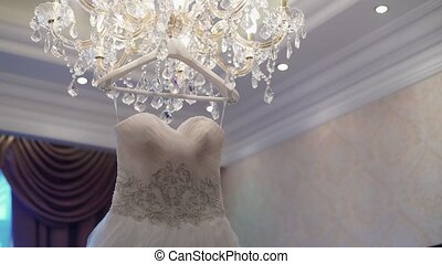 Wedding dress on lamp