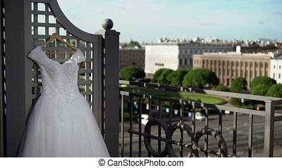 Wedding dress on terrace at sunny day
