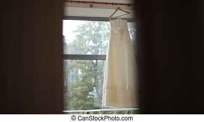 Wedding dress on the white window