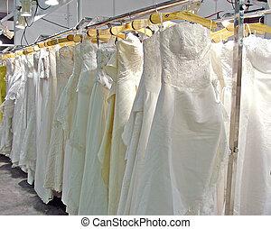 WEDDING DRESS - Many Wedding dress hanging in shop