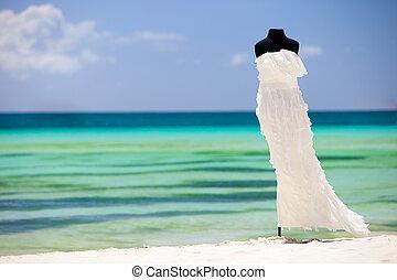 Wedding dress - Beautiful wedding dress on white sand...