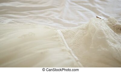 Wedding Dress The bride is on the bed