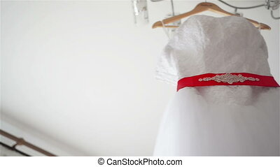 wedding dress tracking - wedding dress hanging on hangers in...