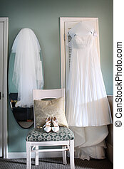 A Brides Dress, Shoes and Veil for her wedding day.