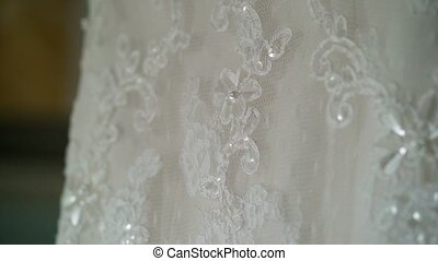 Wedding dress with lace in room shot