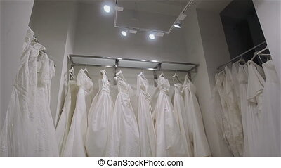 Wedding dresses in bridal boutique