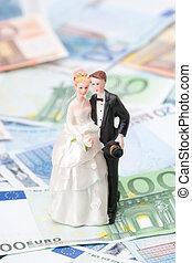 Wedding expense concept - wedding figurines (bride and...