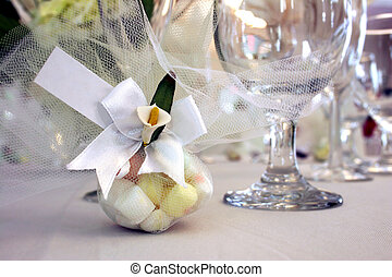 Wedding favor of sweets wrapped in lace on reception table