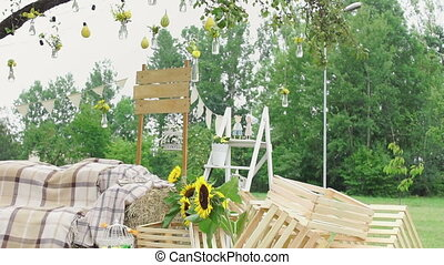 Wedding floristics in a rustic style. Sunflowers decor and...