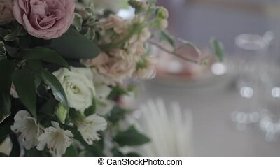 Wedding floristry. Beautiful bouquet on the table, dishes...
