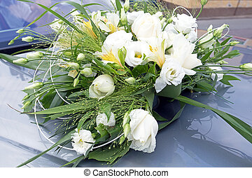 Wedding flowers bouquet close-up on the car