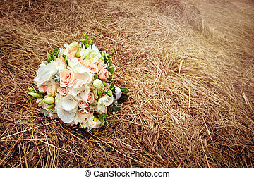 Wedding flowers on the hay field. Rustic style.