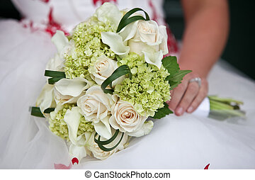 Wedding Flowers - Wedding flowers being held by bride