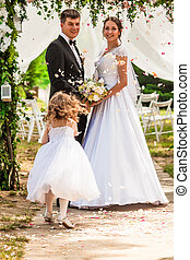 Wedding flying rose petals - Bride and groom on the wedding...