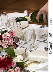 champagne being poured into fluted glasses during a wedding or social event