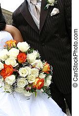 wedding formalwear - Detail shot of a bridge and grooms...